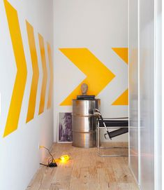 interior by Guilherme Torres Studio- Love the wall graphic and styling.