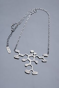 Hops Chemical Structure necklace. I want this so badly I can't stand it!!! This is a MUST for my Christmas wish list :)) Better Living Through Beer http://www.pinterest.com/wineinajug/better-living-through-beer/