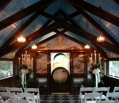 Our wedding chapel can seat up to 60 guests and is adorned with a large German-Romantic mural!
