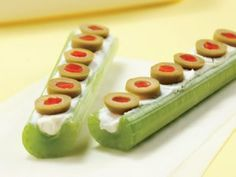 Frogs on a log! Cream cheese (reduced fat-Neufchâtel) and green olives! 100 calories!