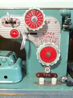 Sewing machine in aqua with red