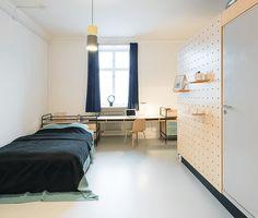 Peg Board wall in dorm room. State-of-the-art student housing: BaseCamp designer dorm in Copenhagen by Studio Aisslinger.