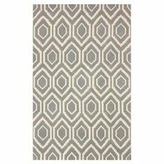Hand-tufted wool rug with a geometric motif.