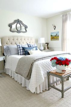 Blue and white guest room with beautiful linens