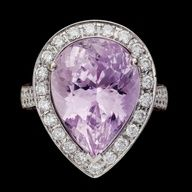 RING, drop cut kunzite, 13.40 cts and brilliant cut diamonds, 1.03 cts, and pk sapphires, 0.52 cts.  18k white gold