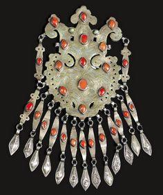 Turkestan | Pectoral ~ dagdan ~ from the Tekke people | Silver, silver gilt, carnelian and green stones (glass?). | 20th century