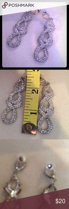 Silver rhinestone chandelier earrings Silver rhinestone chandelier earrings. We're a gift that were bought at Macy's. Drop from ear is about 2 inches. Macy's Jewelry Earrings