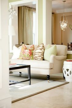 Love the light & airy couch with the pop of color