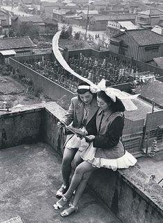 'Dancers Resting on a Rooftop, Asakusa, Tokyo' was taken in 1949, by photographer Takeyoshi Tanuma