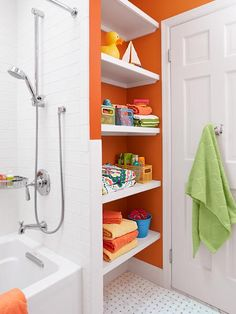 Open shelves neatly stow towels and toiletries within easy reach without adding another door swing to the room. | Photo: Mark Lund