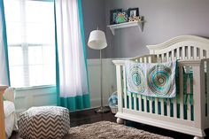 Grey and teal nursery with owls and chevron.