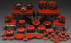 A JAPANESE GILT LACQUERWARE CHILD'S SET, LAST HALF 20TH CENTURY. Comprising two tables and stands, various sized bowls, plates, cups and other items. Largest 8.25 inches (21 cm) square.