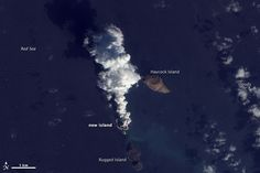 A plume rises from a new island in the Red Sea on Dec. 23, 2011.