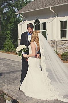 Lace wedding dress with cathedral length lace trimmed veil.