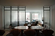 Olde Good Glass - Steel frames were custom made to hold corrugated chicken wire glass as room dividers, in this private apartment in New York City. Living Room Kitchen Partition, Office Room Dividers, Space Dividers, Divider Design, Divider Ideas, Glass Partition, Partition Ideas, Partition Walls, Partition Design