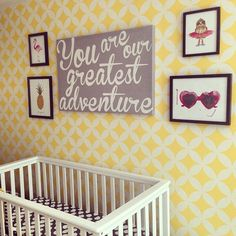 Yellow Stenciled Accent Wall - love this wall paired with funky, eclectic wall art!