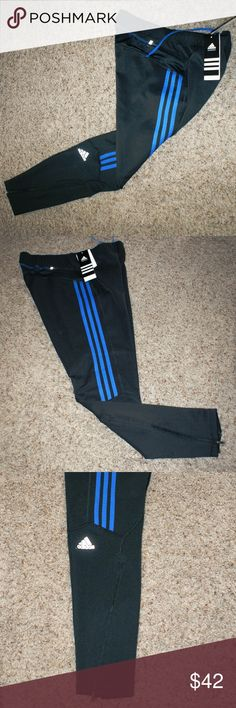 """Men's Adidas Climalite Tights XL....NWT Men's Adidas Climalite Response Running Tights sz XL....NWT....Color: black w/royal blue stripes....rear zip pocket....11"""" leg zippers....smoke/pet free....shipping within 1 business day....please ask any questions.  36"""" length 28 1/2"""" inseam 11"""" leg zippers adidas Pants Sweatpants & Joggers"""