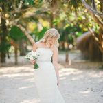 It's official. This gorgeous beach bride deserves some sort of serious medal. Because not only did she plan a destination wedding in locale she'd never even been, but managed to have a ton of fun along the way. The result?