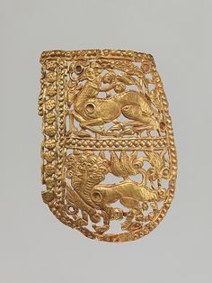 Clothing Plaque with Antelope and Tiger Period: Period of Tibetan Empire Date: 7th–9th century Culture: China (Xinjiang Autonomous Region, Central Asia) Medium: Gold Dimensions: H. 4 1/4 in. (10.8 cm); W. 3 in. (7.6 cm)