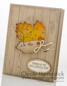 handmade Autum card ... woodgrain panel with negative space maple leaf die cut framing a fall scene ... Stampin' Up!