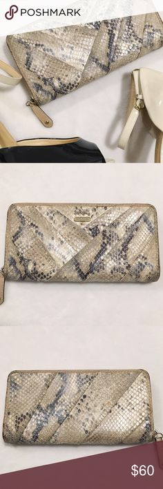 "✨ COACH Snakeskin Wallet ✨ Well loved snakeskin COACH wallet. Luckily the color and snakeskin totally make the blemishes look ""on purpose"" The inside is in AMAZING condition. Please see photos for wear on item!   💁🏾✨Happy Poshing!  🌟 Suggested User 🌟 🙋🏾 Top 10% Sharer/Mentor ⭐️⭐️⭐️⭐️⭐️ 5 star Gal 📫 Fast Shipper!  Ships Same/Next Day📦  🏡 Odor Free 🐩 Pet Free 🚫 No PayPal/No Trades/NO Lowball offers 😀 Coach Bags Wallets"