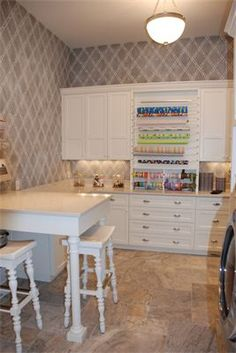 from a Decorative Painting site- but I !!LOVE!! the wrapping center counter in the laundry room!!!
