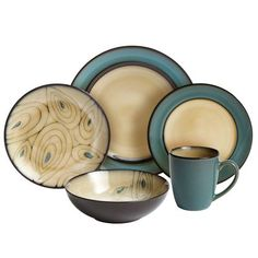 A versatile stoneware collection with rich jewel colors, unique details and the deep shine of a reactive glaze finish. All designed to coordinate but not in a matchy-matchy kind of way. Because you& a bird of a different feather. Peacock Dining Room, Teal Kitchen Decor, Dinner Wear, Jewel Colors, Dinner Plate Sets, Dish Sets, Dinnerware Sets, Dining Room Design, Dining Rooms