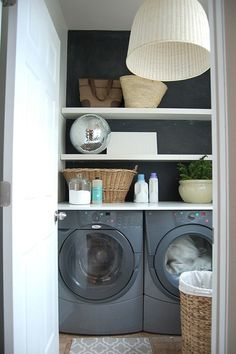 Small laundry room design with opening shelves and side b side washer dryer.
