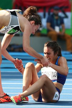Abbey D'Agostino of the United States is assisted by Nikki Hamblin of New Zealand after a collision during the Women's Round 1 - Heat 2 on Day 11 of the Rio 2016 Olympic Games at the Olympic. Get premium, high resolution news photos at Getty Images Rio Olympics 2016, Summer Olympics, Olympic Medals, Olympic Games, Olympic Runners, The Rival, Olympic Champion, Faith In Humanity, Track And Field