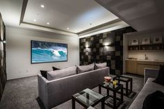 This theater room has tiered seating and a small bar.