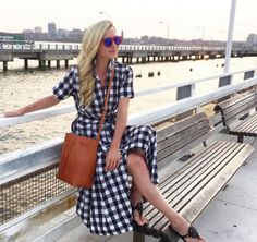 Blair Eadie Bee wears a gingham shirt maxi dress with a brown bucket bag and black sandals.