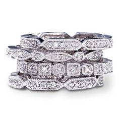 """Sterling Silver Cubic Zirconia 4-Piece Stack Ring Set"" Why settle for just one dazzling cubic zirconia and sterling silver ring when you can have two? For that matter, why settle for two when you could have three? Or, why not, even four? This marvelous set with 103 cubic zirconia stones gives you four times the glamour to wear however you'd like: mixed and matched with your old favorites or all together for maximum sparkle."