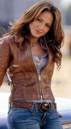 Super hot cowgirl outfit!! Love the leather jacket in this as well as the rest of it!