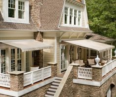 Retractable Awnings with Sunbrella Fabric.  For side porch that is partially covered.  All black or black & white stripe