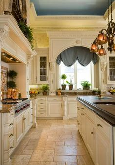 I like this kitchen. Cabinetry, floors, blue accent, and of course the molding