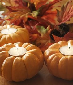 Pumpkin votive holders.  These would make a great Thanksgiving centerpiece.
