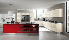 The contemporary spirit can also be expressed by selecting a distinctive colour: Red, for example, can be used on a number of lacquered doors and fronts, creating geometrical contrasts