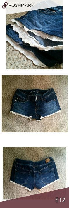 American Eagle cute ruffle shorts Denim shorts, with an ivory ruffle along the bottom. One step up from you plain denim shorts. Double button with a little stretch. True to size. American Eagle Outfitters Shorts Jean Shorts