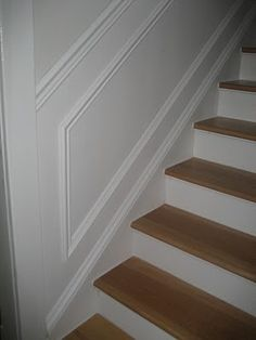 simple wainscoting coming down the staircase (and in the hallway up and downstairs)