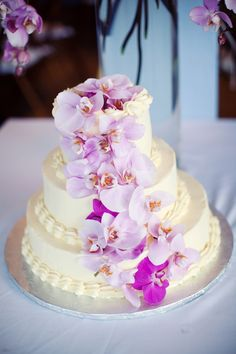 Beautiful wedding cake with cascade of pristine orchids