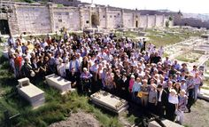 "Survivors saved by Oskar Schindler and their families near Schindler's grave during the filming of Steven Spielberg's ""Schindler's List"", Jerusalem"