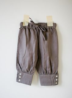 Child trousers made from recycled men's shirt sleeves.
