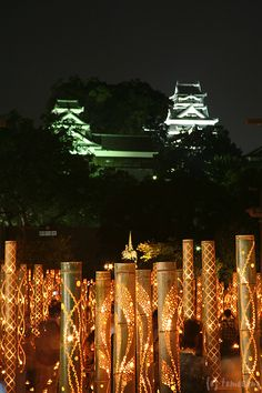 Bamboo lanterns and Kumamoto castle, Japan