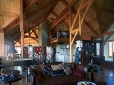 The timber framed areas in this house include the front entrance, the great room and family room, kitchen, and dining room, a master suite and more