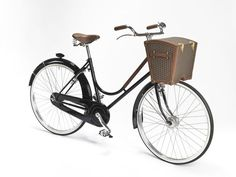 Reviving the forgotten tradition of trunks, #Moynat has launched the #BicycleTrunk. Perched between the front wheel and the handlebars, the trunk in #Moynat canvas conceals a fully equipped picnic basket.