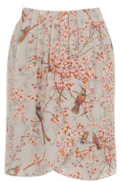 We love this adorable printed skirt with our signature bird print across the fabric. The piece features an asymmetric wrap front and high waistline. The skirt features pleat detailing for a flattering finish.