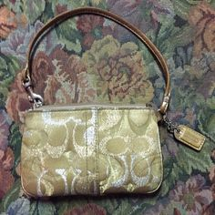 Coach Wristlet This is a very pretty Coach. Very much pre loved buy in terrific condition. Looks like maybe inside could use a little cleaning by the zipper but overall, excellent condition Coach Bags Clutches & Wristlets