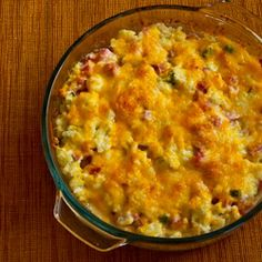 Ham and Cauliflower Casserole au Gratin  (Makes about 6 servings)  at least 6 cups cauliflower flowerets, cut fairly small (1 large head cauliflower or 1 1/2 small heads)  1/2 tsp. salt (for water to cook cauliflower)   2 cups diced lean ham   4 oz. reduced-fat cream cheese, softened  3/4 cup fat-free Greek yogurt   2 T finely-grated Parmesan cheese  1/4 cup thinly sliced green onions  fresh ground black pepper to taste  3/4 cup grated low-fat cheese (I used Four Cheese Mexican Blend