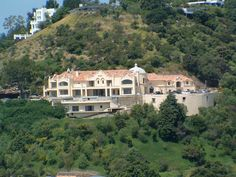 """Site of the Manson Murders:  The home was located at 10050 Cielo Dr. in Benedict Canyon, just outside of Hollywood. It has since been torn down and the address has been changed to 10066 Cielo Drive. It is now called """"Villa Bella"""" (pictured). The home next to the property is owned by Hollywood producer David Oman. He says it is haunted and reports that many strange things happen there on a regular basis."""