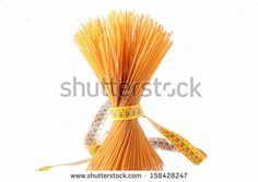 Wholemeal spaghetti and centimeter isolated on white by rossella, via Shutterstock